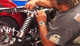 Photo of a service technician servicing a bike at American Harley-Davidson